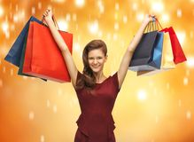 Adolescente en vestido rojo con los panieres Fotografía de archivo libre de regalías