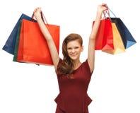 Adolescente en vestido rojo con los panieres Imagen de archivo libre de regalías