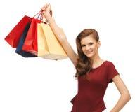 Adolescente en vestido rojo con los panieres Imágenes de archivo libres de regalías