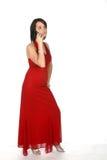Adolescente en vestido rojo en el teléfono Imagenes de archivo