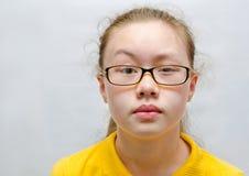 Adolescente en vidrios Imagen de archivo libre de regalías