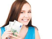 Adolescente encantador con el dinero Fotografía de archivo