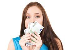 Adolescente encantador con el dinero Imagen de archivo