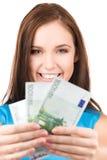 Adolescente encantador con el dinero Foto de archivo
