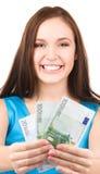 Adolescente encantador con el dinero Fotos de archivo