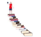 Adolescente encima de escalera del libro Fotografía de archivo libre de regalías