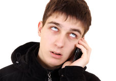 Adolescente enfadado con el teléfono Fotografía de archivo