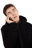 Adolescente enfadado con el teléfono móvil Imágenes de archivo libres de regalías