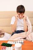 Adolescente enfermo Imagenes de archivo