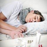 Adolescente enfermo Fotos de archivo