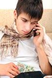 Adolescente enfermo con el dinero Fotografía de archivo