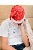Adolescente enfermo con el termómetro Foto de archivo libre de regalías