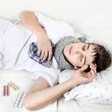 Adolescente enfermo con gripe Fotografía de archivo libre de regalías