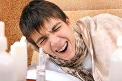 Adolescente enfermo que bosteza Imagen de archivo