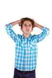 Adolescente enojado aislado en el fondo blanco Fotos de archivo