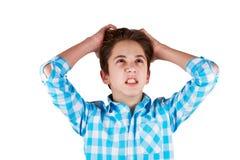 Adolescente enojado aislado en el fondo blanco Fotos de archivo libres de regalías