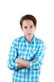 Adolescente enojado aislado en el fondo blanco Imagenes de archivo