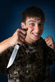 Adolescente enojado con el cuchillo Foto de archivo libre de regalías