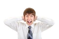 Adolescente enojado con los oídos cerrados Imagenes de archivo
