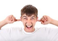 Adolescente enojado con los oídos cerrados Imagen de archivo
