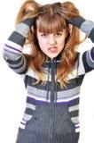 Adolescente enojado desorganizando su pelo Imagenes de archivo