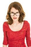 Adolescente enojado en vestido rojo Fotografía de archivo libre de regalías