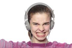 Adolescente entusiasta con los auriculares Imágenes de archivo libres de regalías