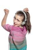 Adolescente entusiasta con los auriculares Imagenes de archivo