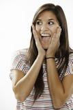 Adolescente excitée sur le fond blanc photographie stock
