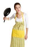 Adolescente fêmea com uma frigideira. Imagens de Stock Royalty Free