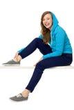 Adolescente fêmea que desgasta a parte superior encapuçado Foto de Stock Royalty Free