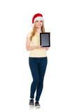 Adolescente felice che posa in un cappello di Natale su bianco Fotografie Stock Libere da Diritti