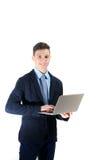 Adolescente felice dello studente che lavora al computer portatile isolato Fotografia Stock Libera da Diritti