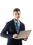 Adolescente felice sul lavoro dell'istituto universitario sul computer portatile isolato su backg bianco Immagine Stock Libera da Diritti