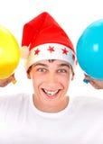 Adolescente feliz con dos globos Foto de archivo