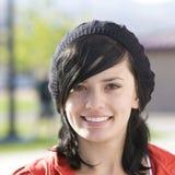 Adolescente feliz con el casquillo Imagen de archivo