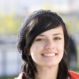Adolescente feliz con el casquillo Fotos de archivo
