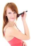Adolescente feliz con el cepillo del maquillaje Foto de archivo libre de regalías
