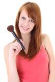 Adolescente feliz con el cepillo del maquillaje Foto de archivo