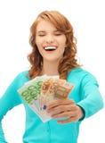 Adolescente feliz con el dinero euro del efectivo Imagen de archivo