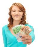Adolescente feliz con el dinero euro del efectivo Fotografía de archivo libre de regalías