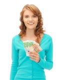 Adolescente feliz con el dinero euro del efectivo Fotografía de archivo