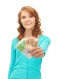 Adolescente feliz con el dinero euro del efectivo Imágenes de archivo libres de regalías