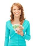 Adolescente feliz con el dinero euro del efectivo Foto de archivo libre de regalías