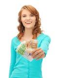 Adolescente feliz con el dinero euro del efectivo Imagen de archivo libre de regalías