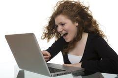 Adolescente feliz con el ordenador Fotografía de archivo