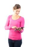 Adolescente feliz con el ordenador de la tablilla Imagenes de archivo
