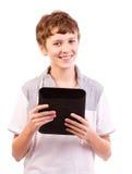 Adolescente feliz con el ordenador de la tablilla Fotos de archivo