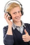 Adolescente feliz con el pulgar-para arriba de los auriculares Imágenes de archivo libres de regalías