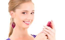 Adolescente feliz con el teléfono celular Foto de archivo libre de regalías